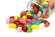 Colorful jelly beans in a jar on white background Stock Photo