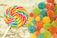 Colorful jelly beans and lollypop. Close to wallpaper Stock Photos