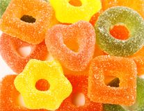 Colorful jelly candies in heart shape and gear as background Royalty Free Stock Photo
