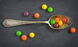 Colorful jelly candies in spoon stock image