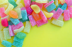 Colorful jelly candies  on yellow Stock Images