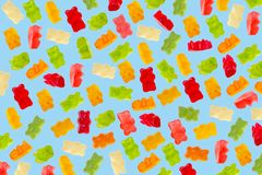 Colorful jelly candy gummy bears on blue background royalty free stock images