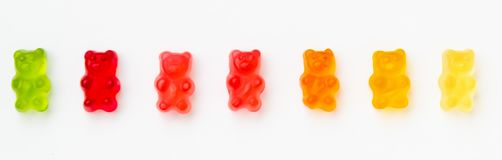 Colorful jelly candy gummy bears. On white background. Green, red, orange and yellow colors. Panorama view stock photos