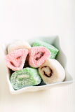 Colorful jelly - like sweet rolls Stock Images