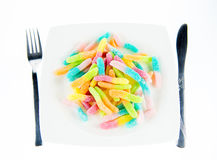 Colorful jelly sweets. Served in a plate, unhealthy dinner Stock Image