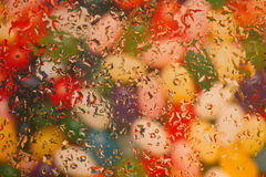 Colorful Jellybean background with waterspots. Celebrate Easter with this waterdropped jellybean background image royalty free stock photo