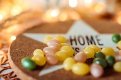 Colorful jellybeans candy and inscription home in the blurred composition royalty free stock photo