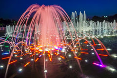 Colorful jet fountain at night Royalty Free Stock Image