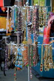 Colorful jewelry hanging from metal rods Royalty Free Stock Image