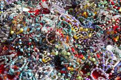 Colorful jewelry mess in market background Royalty Free Stock Image