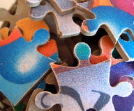 Colorful jigsaw puzzle pieces. A closeup view of a jumble of jigsaw puzzle pieces Stock Image