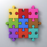 Colorful jigsaw puzzle pieces concept on white wall background with shadow Stock Photography