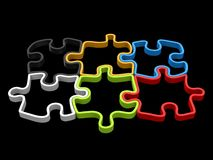 Colorful jigsaw puzzle pieces that fit together - 3D outlines. Side view Royalty Free Stock Photography