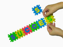 Colorful jigsaw puzzle and two hand Royalty Free Stock Photography