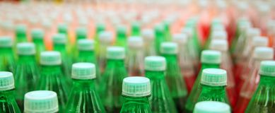 Colorful juice beverage plastic bottle in factory. Line Stock Photography