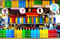 Colorful juice bottles. Funny store on the beach in Mumbai with lots of juice bottles in different colors Royalty Free Stock Photography