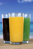 Colorful juices in glasses Stock Photo