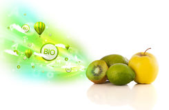 Colorful juicy fruits with green eco signs and icons Royalty Free Stock Photography