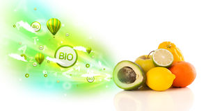 Colorful juicy fruits with green eco signs and icons Stock Image