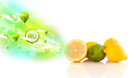 Colorful juicy fruits with green eco signs and icons Stock Photos