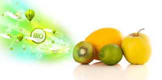 Colorful juicy fruits with green eco signs and icons. On white background Royalty Free Stock Image