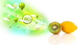 Colorful juicy fruits with green eco signs and icons Stock Photography