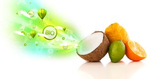 Colorful juicy fruits with green eco signs and icons. On white background Royalty Free Stock Photo