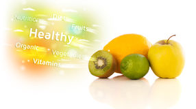 Colorful juicy fruits with healthy text and signs Royalty Free Stock Images