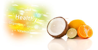 Colorful juicy fruits with healthy text and signs Stock Image