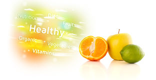 Colorful juicy fruits with healthy text and signs Stock Photography