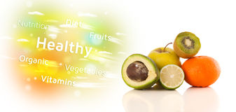 Colorful juicy fruits with healthy text and signs Stock Images