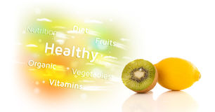 Colorful juicy fruits with healthy text and signs Royalty Free Stock Photo