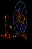 Colorful July 4th Ferris Wheel and Carnival at Night Stock Photography