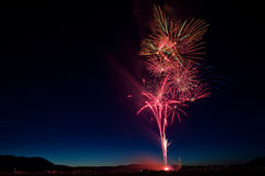 Colorful July 4th Fireworks Celebration at Twilight Stock Images