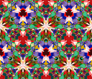 Colorful kaleidoscope background. Seamless pattern composed of color abstract elements located on white background. Royalty Free Stock Image