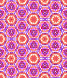 Colorful kaleidoscopic tie dye pattern. Hand made seamless kaleidoscopic tie dye pattern. Traditional technique for textile coloring. Japanese shibori in pink Royalty Free Stock Photo