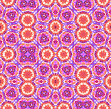 Colorful kaleidoscopic tie dye pattern. Hand made seamless kaleidoscopic tie dye pattern. Traditional technique for textile coloring. Japanese shibori in pink Stock Images