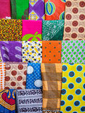 Colorful kangas and kitenges on a stand in East Africa Royalty Free Stock Photos