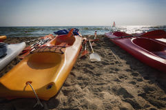 Colorful kayak and sailboat Royalty Free Stock Photos
