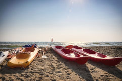 Colorful kayak and sailboat Stock Image