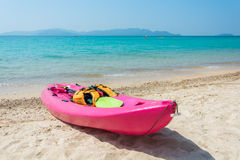 Colorful kayak on tropical beach Royalty Free Stock Photo