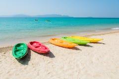 Colorful kayak on tropical beach Stock Photo