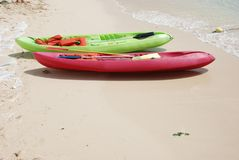 Colorful Kayaks on the Beach. Colorful kayas along the beach Royalty Free Stock Image