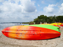 Colorful Kayaks on Beach Stock Photography