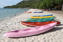 Colorful Kayaks on the Beach Royalty Free Stock Photos