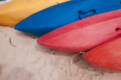 Colorful kayaks on beach in Thailand Stock Images