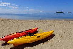 Colorful kayaks on a beach, Vanua Levu island, Fiji Stock Image