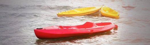 Colorful kayaks on the beach of the Vuligmeni Marine Lake stock photo
