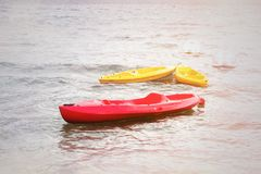 Colorful kayaks on the beach of the Vuligmeni Marine Lake stock photos