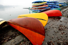Colorful Kayaks and canoes in a Row stack Royalty Free Stock Photography